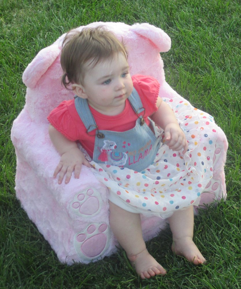 Evelyn in chair cropped.jpg