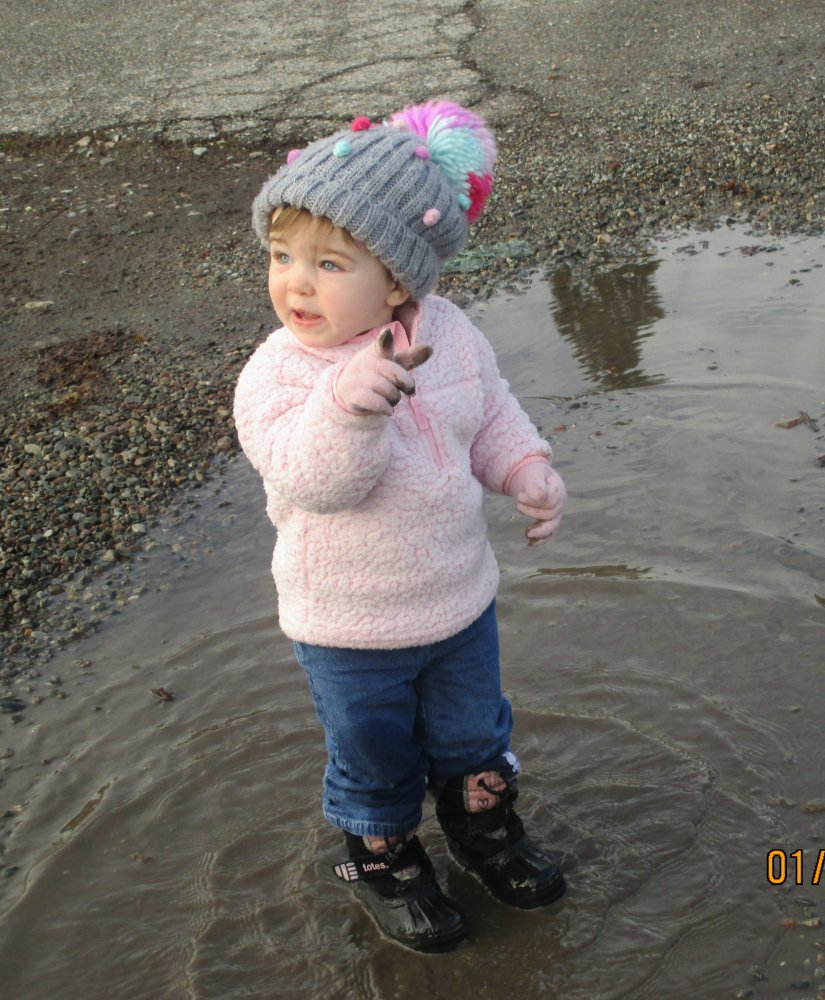 Evelyn in puddle.jpg