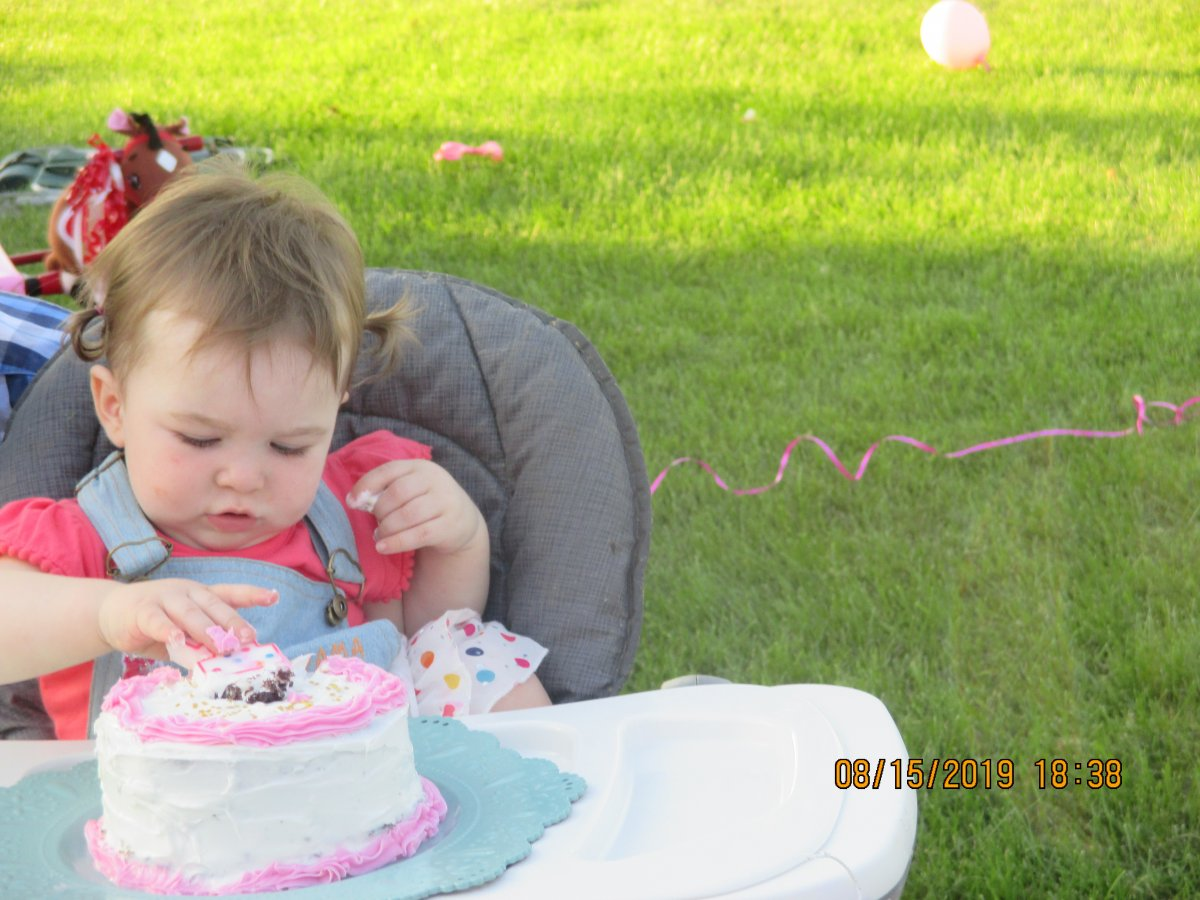 Evelyn touches cake.JPG
